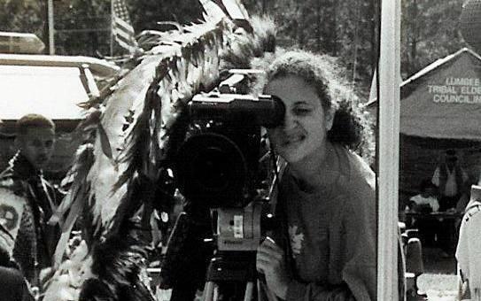 Portrait of Malinda Maynor Lowery Operating a Camera
